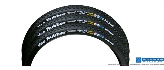 Tyre with rubber decal label patch